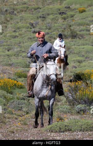 Gaucho guide and tourist on horse at Estancia Alta Vista, El Calafate, Parque Nacional Los Glaciares, Patagonia, Argentina, South America