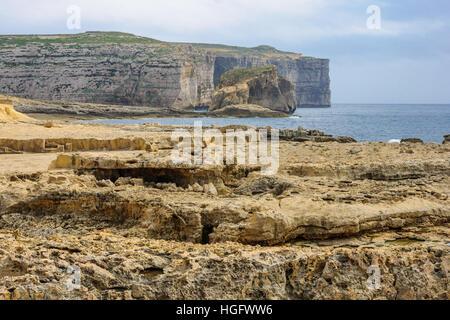 Rocky shore and cliffs near the Azure Window, Gozo Island, Malta - Stock Photo
