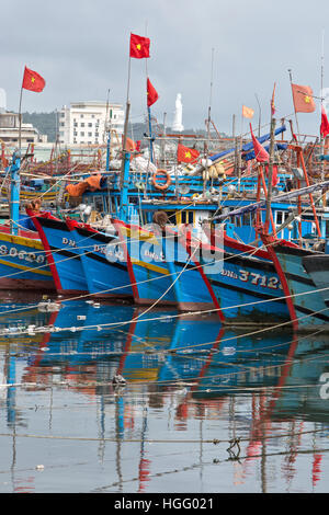 Colorful commercial fishing boats anchored in protected Da Nang harbor. - Stock Photo