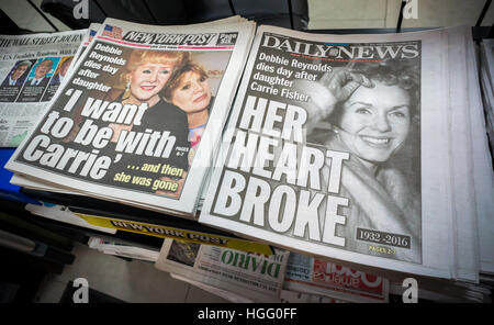 Front pages and headlines of the New York tabloid newspapers on Thursday, December 29, 2016 report on the previous - Stock Photo