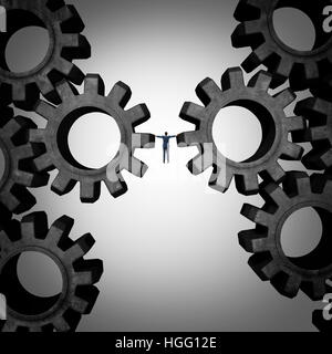 Business management concept as a boss or businessman holding the gears of an industrial machine as a financial corporate - Stock Photo