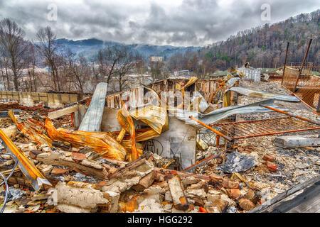 GATLINBURG, TN/USA - December 14, 2016: A motel complex lies in ruins after a major forest fire roared through Gatlinburg - Stock Photo