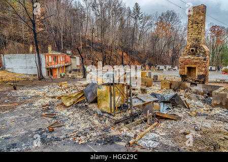 GATLINBURG, TENNESSEE/USA - DECEMBER 14, 2016: A tourist cabin that has been burned to the ground  by a forest fire - Stock Photo