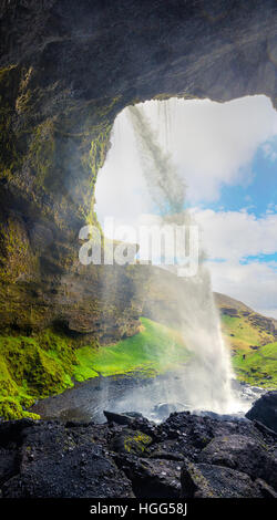 Colorful morning view from the middle of Kvernufoss waterfall. Majestic scene in south Iceland, Europe. - Stock Photo