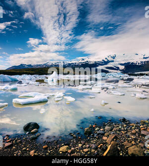 Floating ice box on the Fjallsarlon glacial lagoon. Sunny morning in Vatnajokull National Park, southeast Iceland, - Stock Photo