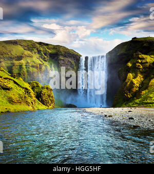 Colorful summer scene with pure water of Skogafoss Waterfall. Sunny morning on the Skoga river, south of Iceland, - Stock Photo