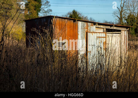 tin corrugated iron shed hut in field