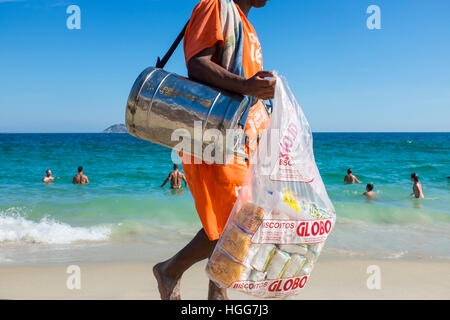 RIO DE JANEIRO - FEBRUARY 26, 2016: Beach vendor selling mate, the South American tea, and Globo brand biscuits, - Stock Photo