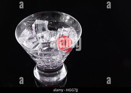 Sparkling beverage in a martini glass with a raspberry - Stock Photo