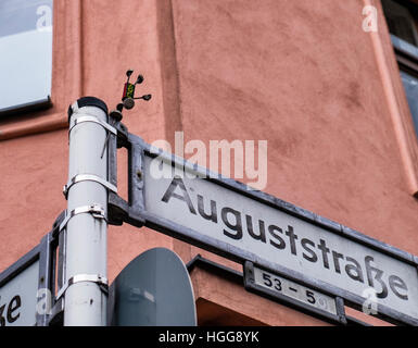 Street art, Cork yogi, Kork yogi, Miniature man made of cork on Street sign, Auguststrasse, Berlin, Mitte. - Stock Photo