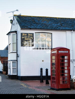 Burnham on Crouch,Essex. Star Inn pub & old red telephone box at Riverside village & holiday resort on tidal Crouch - Stock Photo
