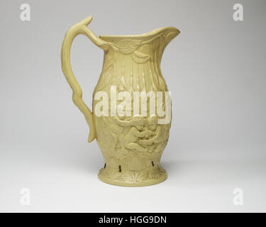 antique English stoneware ewer. Decorated in high relief with Bacchus putti, flowers and leaves. The ewer measures - Stock Photo