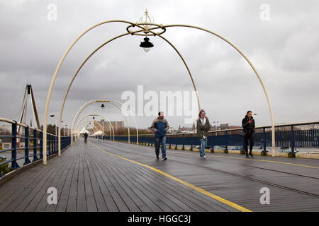 Southport Pier, Merseyside, UK. 9th January, 2017. UK Weather. Walkers brave Heavy Showers and blustery winds to - Stock Photo