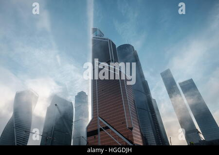 Moscow, Russia. 9th Jan, 2017. A view of the Moscow City business centre hazed in mist as frost hits the cty. © - Stock Photo