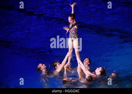 Moscow, Russia. 9th Jan, 2017. Swimmers perform at the synchronised swimming show given at the Dynamo Sports Palace - Stock Photo