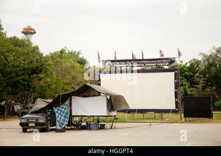 Outdoor cinema movies theater for show people in the playground at night time in temple festivals at Wat Phai Rong - Stock Photo