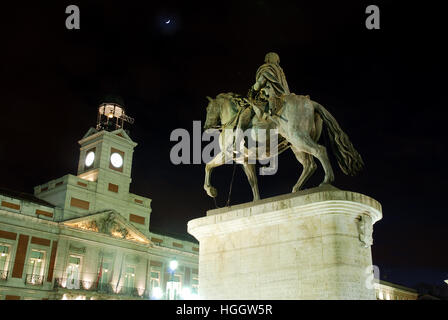 Carlos III statue and clock tower, night view. Puerta del Sol, Madrid, Spain. - Stock Photo