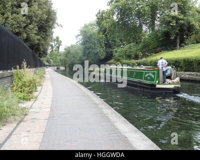 Narrowboat along the Regents canal passing London zoo - Stock Photo