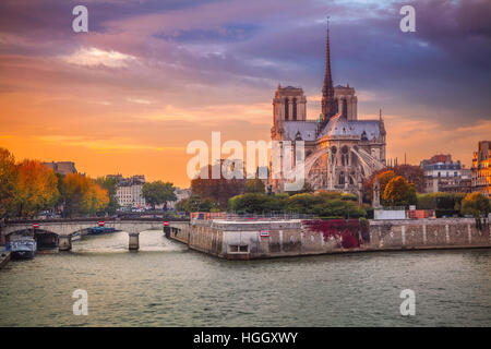 Paris. Cityscape image of Paris, France with the Notre Dame Cathedral during sunset. - Stock Photo