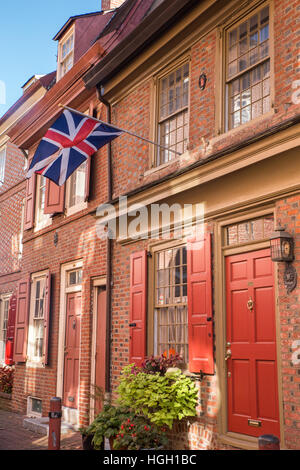 elfreth s alley red brick house window with blue shutters