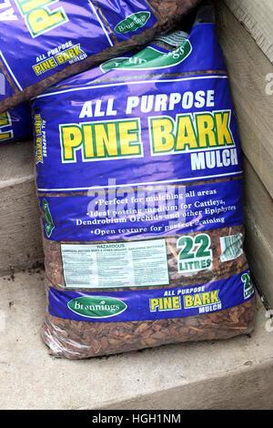 Garden Pine bark mulch in a bag - Stock Photo