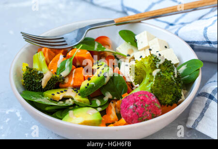 Green vegan salad with broccoli, beetroot and sweet potato falafel. - Stock Photo