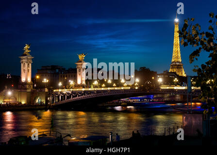 View on Eiffel Tower and Bridge of Alexander in night Paris, France - Stock Photo