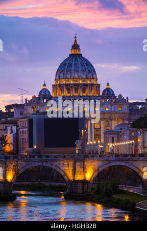 The Papal Basilica of St. Peter in the Vatican city at night - Stock Photo
