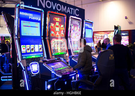 Sofia, Bulgaria - November 24, 2016: A a man plays on a slot machine in a casino equipment exhibition in Inter Expo - Stock Photo