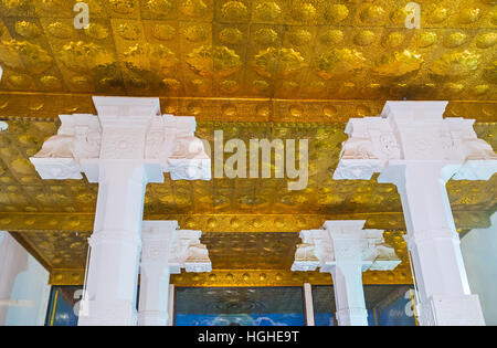 The golden ceiling in the Image House of Bodhi Tree Temple, decorated with relief patterns - Stock Photo