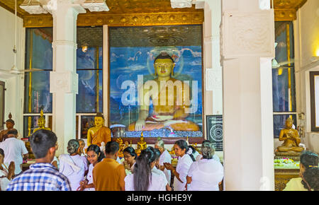 The statue of Touching Earth Buddha, decorates the Image House of Bodhi Tree Temple - Stock Photo
