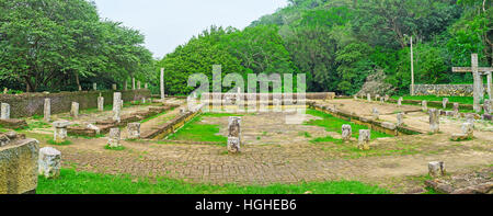 The ruins of the ancient Refectory of Buddhist Monks of Mihintale Monastery Complex, located on the mountain slope - Stock Photo