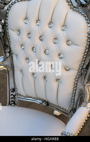 Ancient Chair In White Leather And Diamond Buttons That Looks Like A Throne  Of A Queen