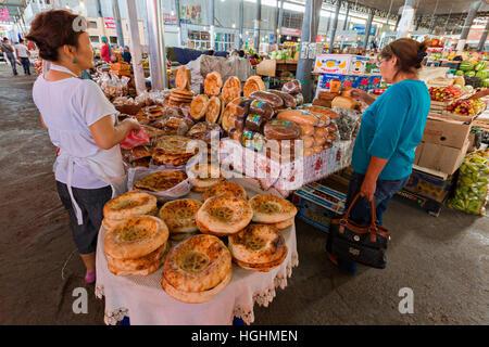 Kazakh women shop in the Samal Bazaar in Shymkent, Kazakhstan - Stock Photo