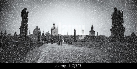 Romantic wintry scene: Snow on Charles Bridge, Prague, Czech Republic. Textured and digitally altered photo. - Stock Photo
