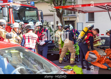 Firefighters getting ready to intervene on chemical accident location. - Stock Photo