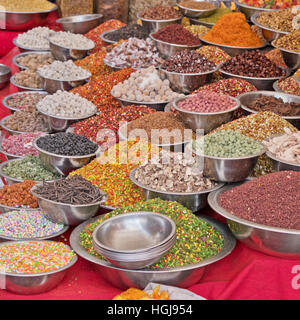 Some of the contents of a sweet and spice stall in a street market in Ahmedabad, India - Stock Photo