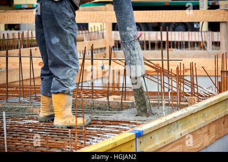 construction site pouring concrete - Stock Photo