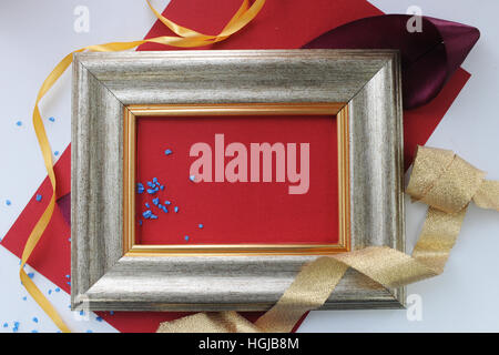 Gold decorated frame mockup with pink and purple flower bouquet ...