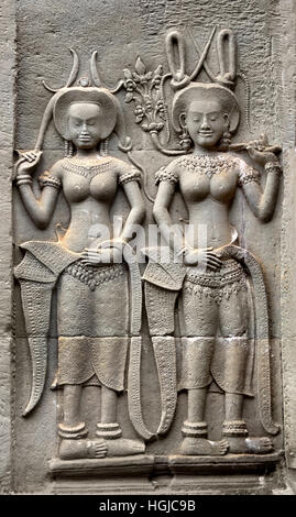 Angkor Wat temple largest religious monument in the world, constructed as a Hindu temple of god Vishnu for the Khmer - Stock Photo