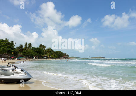 People and two jet skis at the Chaweng Beach on Koh Samui in Thailand. - Stock Photo