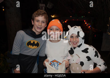 Halloween trick or treaters in Batman and cow costumes. St Paul Minnesota MN USA - Stock Photo