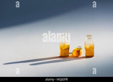Group of three soft candy / jelly beans in the shape of bottles. Looks like group of three people. Middle bottle - Stock Photo