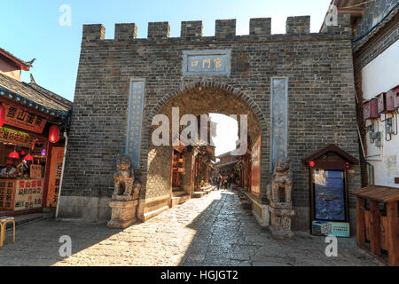 Lijiang, China - November 13, 2016: Close view of one of old gates of Lijiang Old Town used to access the city - Stock Photo