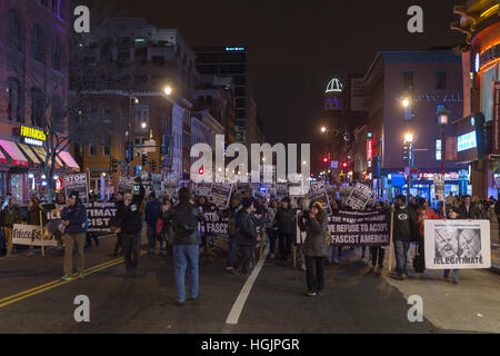 Washington, USA. 16 Jan, 2017. Protesters with 'Refuse Fascism' march and demonstrate on the streets of Washington, - Stock Photo