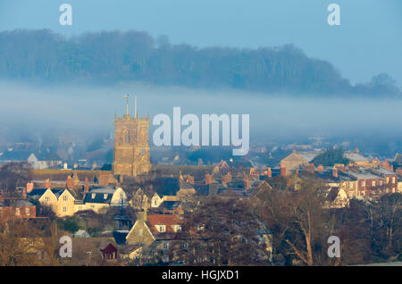 Bridport, Dorset, UK. 23rd Jan, 2017. UK Weather. Mist hanging in the air behind St Mary's Church tower in Bridport - Stock Photo