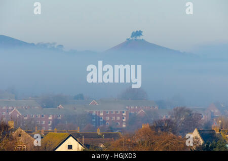 Bridport, Dorset, UK. 23rd Jan, 2017. UK Weather. The peak of Colmers Hill poking above the fog bank to the west - Stock Photo