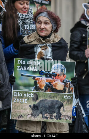 Gdansk, Poland. 23rd Jan, 2017. Protesters wearing the animal masks outside the Law and Justice ruling party office - Stock Photo