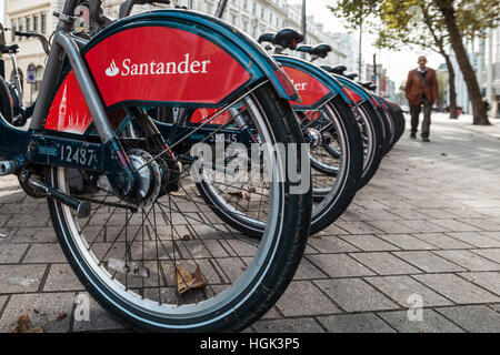 London, United Kingdom - October 17, 2016: Row of Santander 'Boris Bikes' - these are bicycles available to hire - Stock Photo
