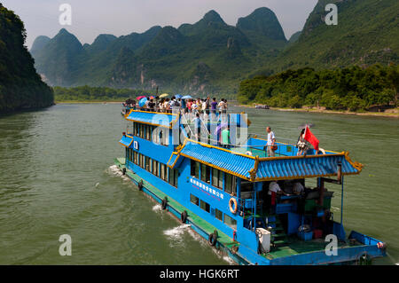 Li River, China - August 1, 2012: A passenger boat making the trip between Guilin in Yangshuo in the Li River, in - Stock Photo
